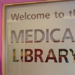 Welcome to the Medical Library etched into the frosted glass of door