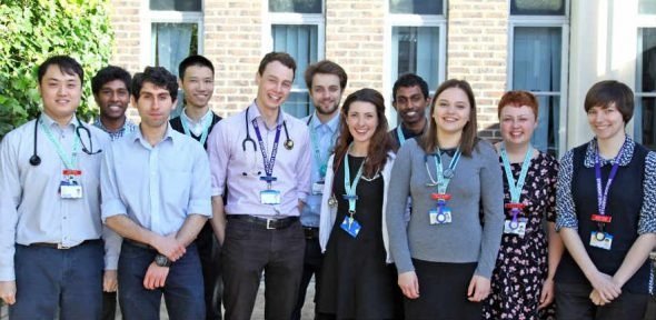 Group of medical students posing for a photograph outside of the Clinical School