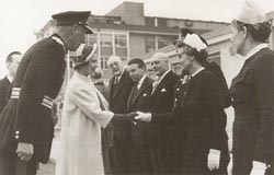 Black and white photograph of Her Majesty the Queen opening New Addenbrookes, shaking hand with staff outside what appears to tbe current Outpatients entrance