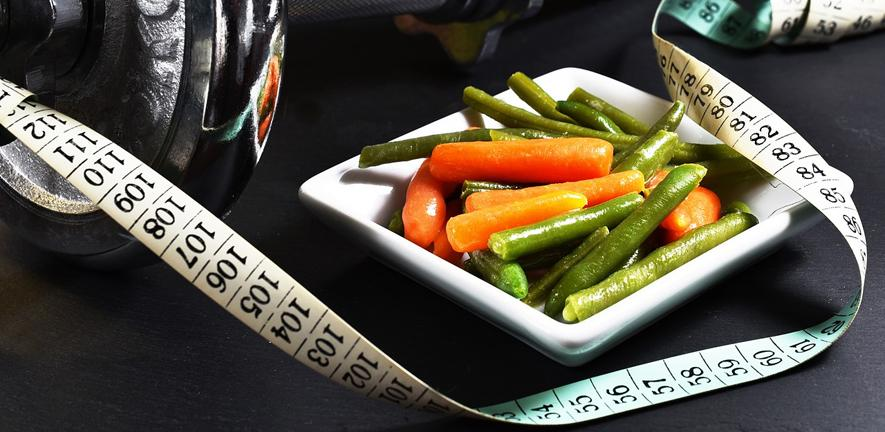 Photo of a plate of nice looking cooked veg on a plate, with a tape measure alongside it