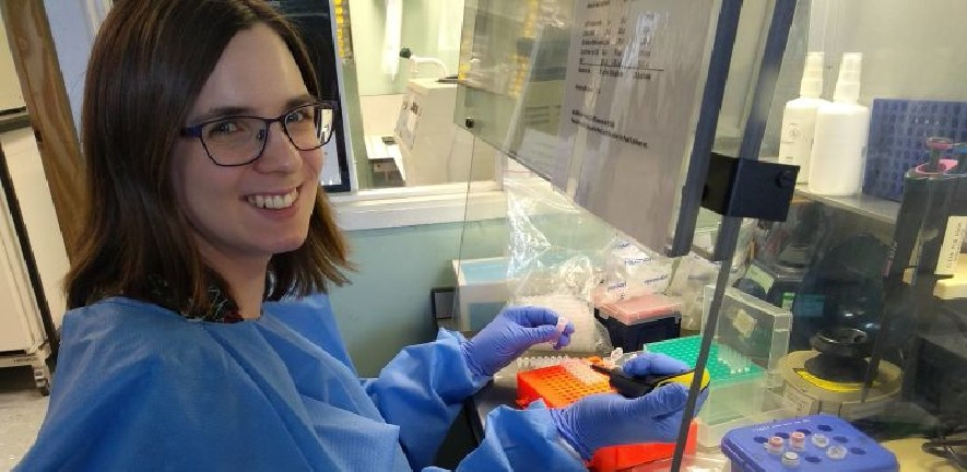 Photo of Dr Charlotte Houldcroft working in her laboratory